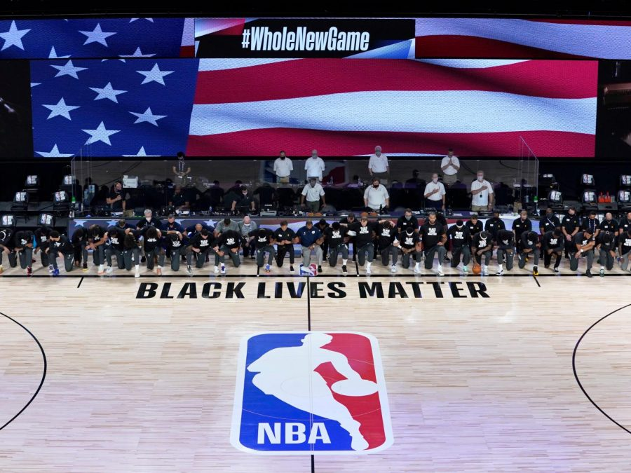 NBA+players+kneel+during+the+National+Anthem.