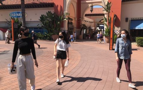 Friends hanging out safely at Irvine Spectrum.