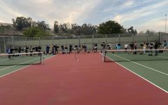 Marching Band practicing on the tennis courts.