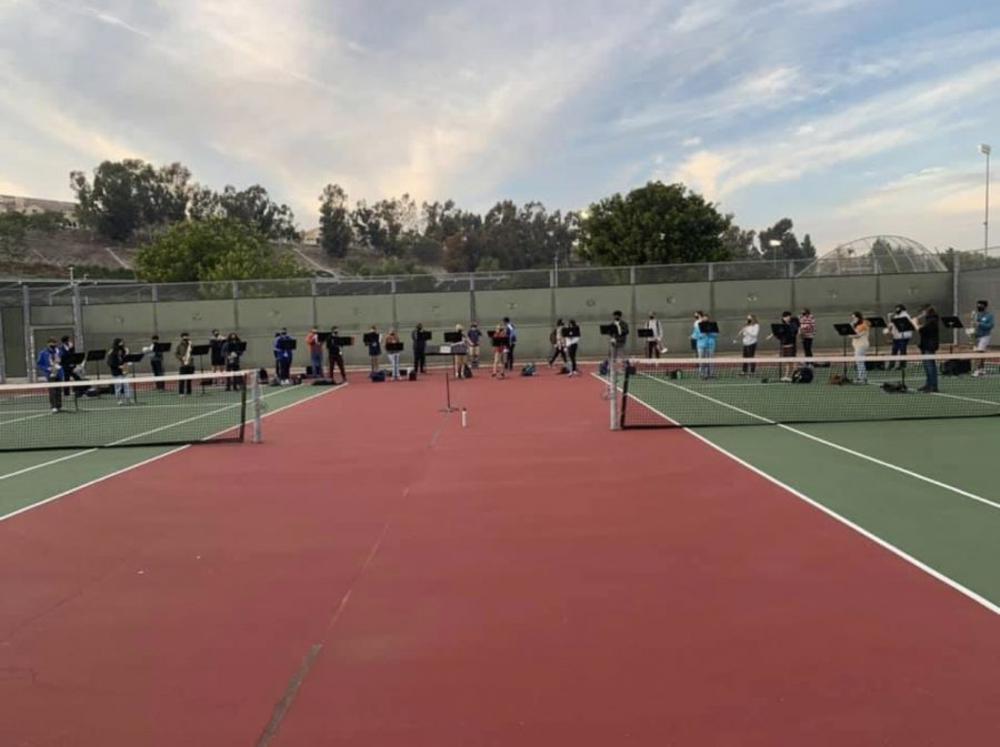 Marching+Band+practicing+on+the+tennis+courts.