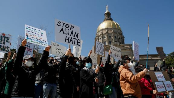 People hold placards during a