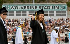 A graduate waves to family during the Aliso Niguel High School graduation June 6, 2019.  (Photo by Michael Fernandez, Contributing Photographer)