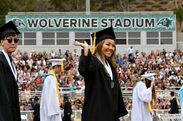 A+graduate+waves+to+family+during+the+Aliso+Niguel+High+School+graduation+June+6%2C+2019.++%28Photo+by+Michael+Fernandez%2C+Contributing+Photographer%29